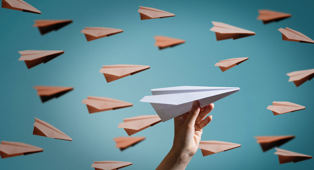 Paper plane on blue background.
